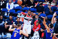 Wizards John Wall dishes the ball to teammate. New York defeated Washington 115-104 during a NBA preseason game at the Verizon Center in Washington, D.C. on Friday, October 9, 2015.  Alan P. Santos/DC Sports Box