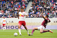 Tyrone Marshall (34) of the Colorado Rapids comes in for a tackle on Rafa Marquez (4) of the New York Red Bulls. The New York Red Bulls defeated the Colorado Rapids 4-1 during a Major League Soccer (MLS) match at Red Bull Arena in Harrison, NJ, on March 25, 2012.