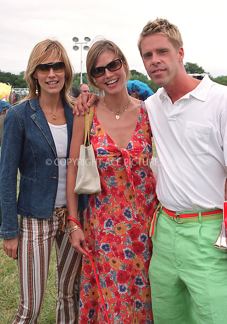 """(L to R) Molly Sims, Heidi Klum and fashion photographer Stewart Shining at the Fifth Annual """"Super Saturday"""" designer sale and family event to benefit the ovarian cancer research fund. Water Mill, Long Island. July 27, 2002. Please byline: Alecsey Boldeskul/NY Photo Press.   ..*PAY-PER-USE*      ....NY Photo Press:  ..phone (646) 267-6913;   ..e-mail: info@nyphotopress.com"""