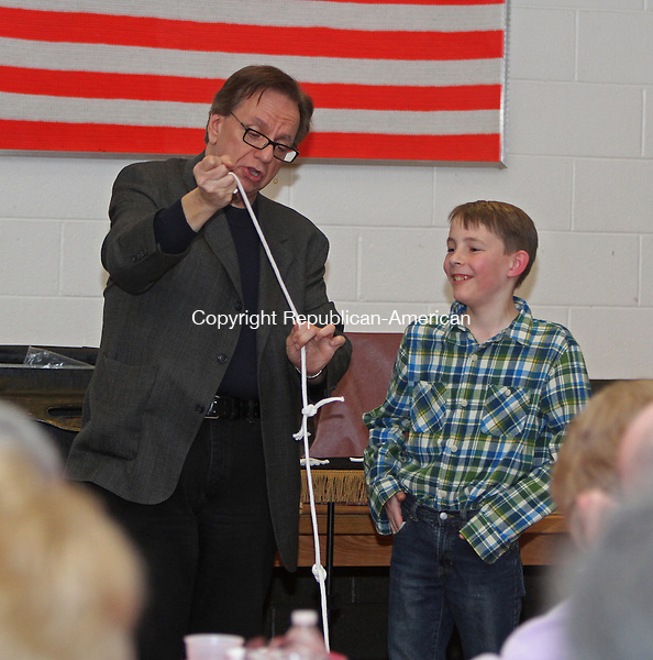 Middlebury, CT-032115MK03 Alex Kennon reacts as Magician Jim Sisti performs during A Night of Magic at the Middlebury fire house Saturday night.  Beverly Dassonville, chair of the event, said that the Middlebury Fire Department Ladies Auxiliary hope to raise over $1000 during the sold out show. Michael Kabelka / Republican-American
