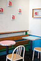 Andr&eacute; Saraiva's new Cafe Henri in Chinatown. On the wall are copies of an Andy Warhol book. In the case, a handbag by Olympia Le-Tan modeled after the same book. <br /> <br /> Danny Ghitis for The New York Times