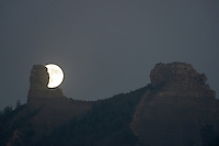 Chimney Rock (left) and Companion Rock (right), with a full moon rising, at Chimney Rock National Monument, in Chimney Rock State Park, in San Juan National Forest, South West Colorado, USA. Every 18.6 years, the moon pauses and rises in the same place for 3 years, between Chimney Rock and Companion Rock as viewed from the Great House Pueblo, in a Major Lunar Standstill. The ridge was an ancestral Puebloan site occupied 925-1125 AD by around 2000 Indians. Chimney Rock was made a National Monument in 2012 and is listed on the US National Register of Historic Places and the Colorado State Register of Historic Properties. Picture by Howard Rowe / Manuel Cohen