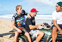PIPELINE, Oahu, Hawaii (Tuesday, December 10, 2013) Bede Durbidge (AUS) is assisted off the beach by lifeguards and doctor after bursting his eardrum in a wipeout. - The 2013 Billabong Pipe Masters in Memory of Andy Irons resumed today in six foot (2 metre) barrels and there was no shortage of drama in the ASP World Title race between Mick Fanning (AUS), 32, and Kelly Slater (USA), 41. There was also a shift in the Vans Triple Crown of Surfing Rankings as well as qualification developments for the 2014 WCT.<br /> <br /> The Billabong Pipe Masters represents the pinnacle of the 2013 ASP World Championship Tour, deciding the ASP World Title, Vans Triple Crown of Surfing, and final slots for 2014 ASP WCT qualification.<br /> <br /> Mick Fanning, two-time ASP World Champion and current No. 1, dominated his Round 3 clash with wildcard Kaimana Jaquias (HAW), 20, but unexpectedly erred in his three-man Round 4 heat against John John Florence (HAW), 21, and Nat Young (USA), 22. A last minute paddle battle with heat leader Florence in the closing seconds of the match took him from second to third and now pits him against one of the best Pipeline surfers in the world: C.J. Hobgood (USA), 34, in Round 5. Meanwhile, Slater skips Round 5 and heads straight to the Quarterfinals after his Round 4 win.<br /> <br /> Clearly disappointed with his misstep, Fanning couldn&rsquo;t leave the beach fast enough and wasn&rsquo;t prepared to talk about how this affects his approach to the final day of competition.<br /> <br /> Kelly Slater was electric in his bid for a historic 12th ASP World Title, earning the high heat-totals of both Round 3 and 4. Slater tore past Mitch Crews (AUS), 23, with a 17.66 out of 20 heat total for incredible Pipeline and Backdoor barrels and backed up the performance with a 17.50 out of 20 in Round 4.<br /> Photo: joliphotos.com