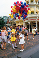 Orlando, Florida - Circa 1986. Families visit Disney World. Disney World is a world-renowned entertainment complex that opened October 1, 1971 in Lake Buena Vista, FL. Now known as the Walt Disney World Resort, the property covers 25,000 acres and has an annual attendance of 52.5million people.