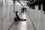 INDIANAPOLIS, IN - MARCH 18:A student athlete recovers in a hall way during the Division I Women's Swimming & Diving Championships held at the Indiana University Natatorium on March 18, 2017 in Indianapolis, Indiana. (Photo by A.J. Mast/NCAA Photos via Getty Images)
