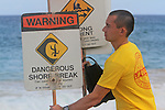A lifeguard post signs on the danger of Sandy Beach in Hawaii.