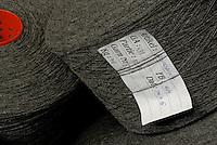 Bobbins of grey woollen thread