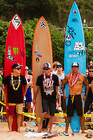 "HONOLULU, Oahu, Waimea Bay - Thursday, November 28, 2012 -- Makua Rothman (HAW), Bruce Irons (HAW) and Kala Alexander (HAW). The 28th annual Quiksilver In Memory of Eddie Aikau official opening ceremony and blessing today at Waimea Bay on the North Shore of Oahu. The ceremony  featured this year's 28 Invitees, including newly elected riders John John Florence (Hawaii), Ian Walsh (Maui), and Alex Gray (California), as well as former ""Eddie"" champions Kelly Slater (Florida), Greg Long (California), and Ross Clarke-Jones (Australia). The surfers will be joined by members of the Aikau family, including Eddie's younger brother and Invitee Clyde Aikau...When the Invitees and Alternates paddled out and grouped in the traditional surfer's circle it's about camaraderie and making a connection to the others who will ultimately share in your experience and watch out for your safety..The holding period for the Quiksilver In Memory of Eddie Aikau will commence on Saturday, December 1, and runs through  to February 28, 2013. The event requires one day of quality waves in the giant range of 20 feet or more. Waves of this size are only generated occasionally by hurricane force winds from intense storms in the Pacific NW. The elements of wind, swell height and arrival time to the island's shore must be in perfect alignment to allow a full eight hours of daytime competition..Waimea Bay was Eddie Aikau's home away from home. It was here that he saved countless lives as the Bay's first official lifeguard, and successfully rode the largest waves of his day. An early pioneer of big wave riding in Hawaii, Eddie has inspired generations of ""storm surfers"" who today roam the globe year-round in search of giant waves..The Quiksilver In Memory of Eddie Aikau has only been held a total of eight (8) times, most recently on December 8, 2009. California's Greg Long (California) took the honor that year. .Photo: joliphotos.com"