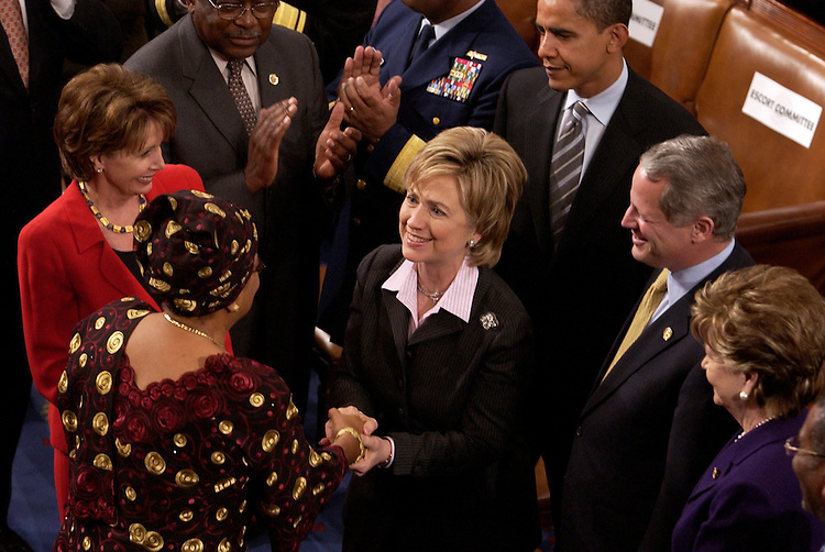 Ellen Johnson Sirleaf, president of the Republic of Liberia, left, greets Sen. Hillary Clinton, D-N.Y., center, in the House Chamber before Sirleaf addressed a joint session of Congress.