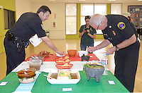 Santa Monica Police Captain Dan Salerno (left) and Santa Monica Deputy Fire Chief Bruce Davis judge the Homemade Salsa Contest Park during the Cinco de Mayo festival at Virginia Avenue Park on Sunday, May 6, 2012.