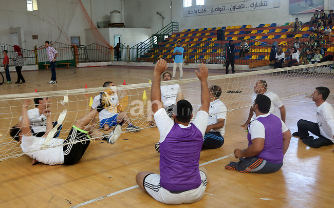 Disabled Palestinians take part in the closing ceremony of the wheelchairs basketball training camp organised by the International Committee of the Red Cross (ICRC) , in Gaza city on june 2, 2016. Photo by Nidal Alwaheidi