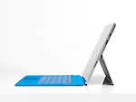 Microsoft Surface Pro 3 tablet computer with a blue keyboard side view isolated on white background