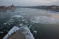 Photographers gather on the edge of an island in the middle of the river to photograph floating ice block on river Danube in front of the Hungarian Parliament's building in Budapest, Hungary on January 09, 2017. ATTILA VOLGYI