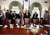 United States President Ronald Reagan meets with Republican Congressional Leadership in the Cabinet Room of the White House in Washington, D.C. on Tuesday, April 28, 1981.  Standing from left to right: unidentified; unidentified; U.S. Senate Majority Whip Ted Stevens (Republican of Alaska); Deputy Assistant to the President for Legislative Affairs Ken Duberstein; U.S. Senate Majority Leader Howard Baker (Republican of Tennessee); unidentified; President Reagan; U.S. House Minority Leader Robert Michel (Republican of Illinois); and U.S. House Minority Whip Trent Lott (Republican of Mississippi)..Mandatory Credit: Michael Evans - White House via CNP