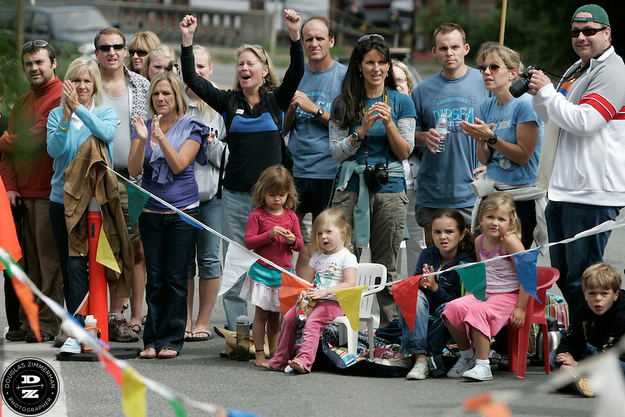 A crowd of onlookers cheer as runners turn off of Highway 1 into the parking lot of Stinson Beach state park  during the 99th running of the Dipsea Race at Sintson Beach State Park in Stinson Beach, Calif. on Sunday June 14th, 2009.