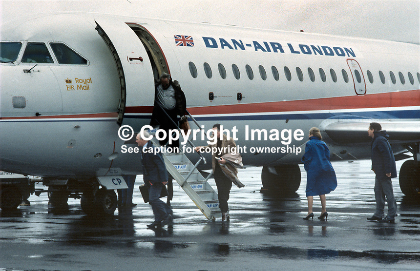 Passengers disembark from first Danair scheduled passenger flight from London Gatwick to Belfast International Airport, 6th February 1984. 19840015DAL2. The aircraft was a BAC 1-11...Copyright Image from Victor Patterson, 54 Dorchester Park, Belfast, UK, BT9 6RJ..Tel: +44 28 9066 1296.Mob: +44 7802 353836.Voicemail +44 20 8816 7153.Skype: victorpattersonbelfast.Email: victorpatterson@me.com.Email: victorpatterson@ireland.com (back-up)..IMPORTANT: If you wish to use this image or any other of my images please go to www.victorpatterson.com and click on the Terms & Conditions. Then contact me by email or phone with the reference number(s) of the image(s) concerned.