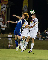 Winthrop University Eagles vs the Brevard College Tornados at Eagle's Field in Rock Hill, SC.  The Eagles beat the Tornados 6-0.  Kyle Kennedy (19) and Augusto Isern (18) fight for a header.