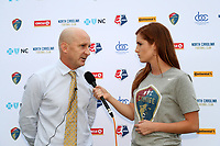 Cary, North Carolina  - Sunday May 21, 2017: Paul Riley is interviewed by Kelly Glendenning after a regular season National Women's Soccer League (NWSL) match between the North Carolina Courage and the Chicago Red Stars at Sahlen's Stadium at WakeMed Soccer Park. Chicago won the game 3-1.