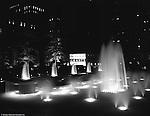 Pittsburgh PA: View of the new Mellon Square at night - 1955. Mellon Square, built in 1953-55 was designed by Mitchell & Ritchey, landscaped by Simonds & Simonds, and paid for by Mellon family foundations.  Rumor has it that the park was built to keep Alcoa Corporation from moving from Pittsburgh to New York City in the early 1950s.  Other building in the photo include:  William Penn Hotel.