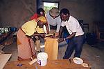 Kenyan Woman & Barrie Callow & Two Gentleman Building Solar Oven