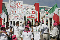 Female supporters hold banners during a rally headed by leftist Andres Manuel Lopez Obrador and the Oil Defense Brigades in Cordoba, Veracruz, May 30, 2008. Lopez Obrador is heading a tour across the country to fight against the privatization of state-owned Petroleos Mexicanos (PEMEX). Photo by Javier Rodriguez