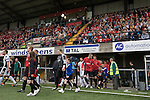 The teams walking on to the pitch at Seaview Park, Belfast before Northern Irish club Crusaders take on Fulham in a UEFA Europa League 2nd qualifying round, fist leg match. The visitors from England won by 3 goals to 1 before a crowd of 3011.