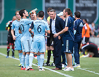 Sporting Kansas City head coach Peter Vermes talks to his team during a Major League Soccer match at RFK Stadium in Washington, DC.  D.C. United tied Sporting Kansas City, 1-1.
