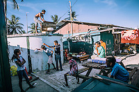 Children play basketball in the courtyard of a house. It is one of the most popular sports among young people on the island. Several dozen makeshift basketball courts have been constructed on the island.
