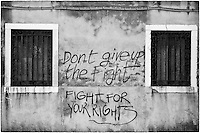 Graffiti on wall in Venice, Italy. Fight for your rights.