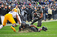 Baltimore, MD - DEC 10, 2016: Army Black Knights running back Kell Walker (32) follows his blocker during game between Army and Navy at M&T Bank Stadium, Baltimore, MD. (Photo by Phil Peters/Media Images International)