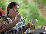 Hilda Coronado ladles a drink into cups during a workshop at an eco-agricultural training center in Comitancillo, Guatemala. The center is sponsored by the Maya Mam Association for Investigation and Development (AMMID).