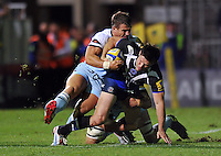 Dan Hipkiss is tackled to ground. Aviva Premiership match, between Bath Rugby and Northampton Saints on September 14, 2012 at the Recreation Ground in Bath, England. Photo by: Patrick Khachfe / Onside Images