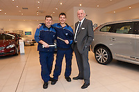 Darren Taylor with his son Jake at Volvo Cars Derby along with General Manager John Ritchie