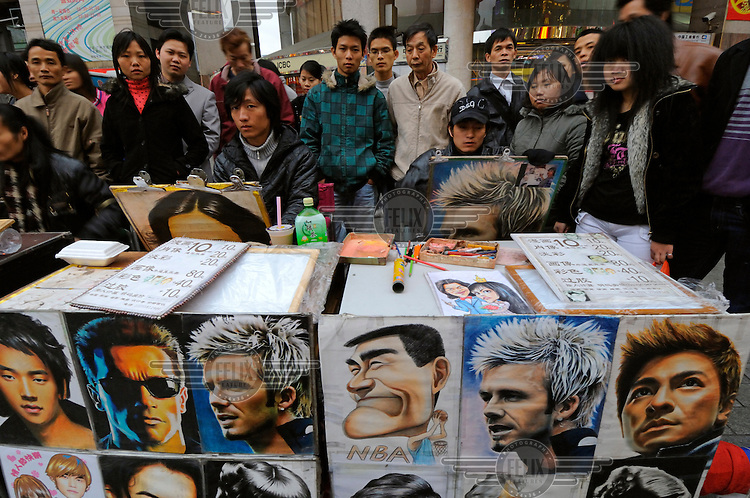 David Beckham alongside the Terminator and Chinese stars, advertising skills of caricaturists - in the Western manner but new to Chinese streets.