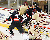 Patrick Wey (BC - 6), Adam Reid (NU - 8) - The Boston College Eagles defeated the visiting Northeastern University Huskies 3-0 after a banner-raising ceremony for BC's 2012 national championship on Saturday, October 20, 2012, at Kelley Rink in Conte Forum in Chestnut Hill, Massachusetts.