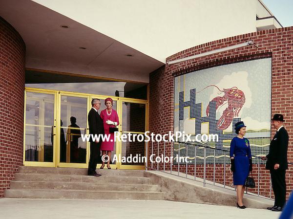 Senior couple standing outside hotel