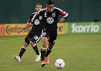 WASHINGTON, DC - OCTOBER 20, 2012:  Andy Najar (14) and Nick DeLeon (18) of D.C United against the Columbus Crew during an MLS match at RFK Stadium in Washington D.C. on October 20. D.C United won 3-2.