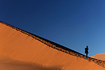 Africa, Namibia, Sossusvlei. Person on dune in the Namib Desert of Sossusvlei.