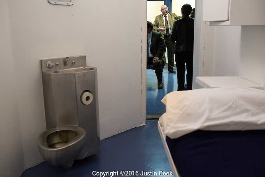 Warden Edward Thomas talks to a tour group outside a cell near the execution room at Central Prison in Raleigh, NC on Thursday, November 17, 2016. (Justin Cook)
