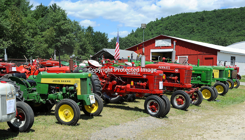 farm tractor lineup at Cheshire Fair in Swanzey, New Hampshire USA