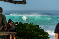 North Shore, Oahu, Hawaii (Friday, November 29, 2013) Damien Hobgood (USA). –  The swell jumped overnight to 15'-20' from the North West. Pipeline was main spot on the North Shore with the contest on at Sunset. Waves were in the triple overhead range with 2nd and #rd reef breaking at Pipe. Photo: joliphotos.com