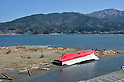 April 1st, 2011, Yamadamachi, Japan - A boat lies overturned after being washed ashore in Yamadamachi, Iwate Prefecture, on April 1, 2011, three weeks after this otherwise sleepy northeastern Japanese fishing vilalge was devastated by a magnitude 9.0 earthquake and ensuing tsunami. (Natsuki Sakai/AFLO) [3615] -mis-...