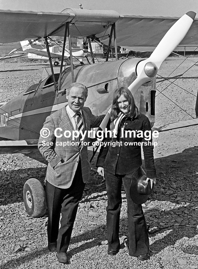 Wartime flying hero Group Captain Douglas Bader, at Newtownards Airfield, N Ireland, to declare open the Ulster Flying Club's new clubhouse pictured in front of a Tiger Moth with club member, Jane Galloway, 20 years, from Holywood, Co Down. 197504750356DB1.<br /> <br /> Copyright Image from Victor Patterson, 54 Dorchester Park, Belfast, UK, BT9 6RJ<br /> <br /> t: +44 28 90661296<br /> m: +44 7802 353836<br /> vm: +44 20 88167153<br /> e1: victorpatterson@me.com<br /> e2: victorpatterson@gmail.com<br /> <br /> For my Terms and Conditions of Use go to www.victorpatterson.com