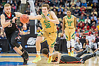 Mar. 19, 2015; Steve Vasturia (32) grabs a loose ball in the second round game of the NCAA Tournament. Notre Dame defeated Northeastern 69-65. (Photo by Matt Cashore/University of Notre Dame)