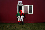 Jockeys pick up their race cards during the annual Dingle Races, the largest flapper races in Ireland, during the first day of the weekend-long event in Dingle, Ireland.