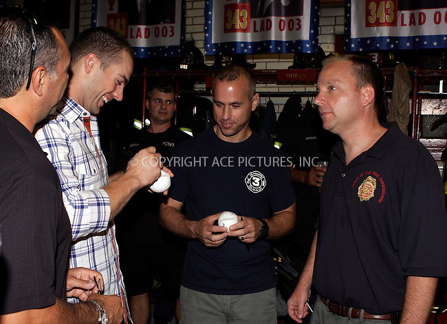 WWW.ACEPIXS.COM . . . . .  ....September 9 2011, New York City....New York Mets baseball player David Wright (2nd L) met Fire Fighters in the East Village on September 9 2011 in New York City....Please byline: NANCY RIVERA- ACEPIXS.COM.... *** ***..Ace Pictures, Inc:  ..Tel: 646 769 0430..e-mail: info@acepixs.com..web: http://www.acepixs.com