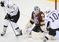 San Antonio Rampage's James Wright (28) and Jon Matsumoto (10) battle Chicago Wolves goaltender Eddie Lack for the puck during the second period of an AHL hockey game, Thursday, April 19, 2012, in San Antonio. Matsumoto gained control of this rebound to score. (Darren Abate/pressphotointl.com)