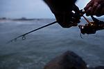 Fishing at Rockaway beach in New York on June 24, 2012.
