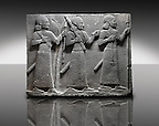 Picture & image of a Neo-Hittite orthostat of 3 warriors from the legend of Gilgamesh from Karkamis,, Turkey. Ancora Archaeological Museum. The warrior on the far left holds a spear in one hand and the branch of a tree in the other. The middle warrior has a clenched fist an carries an impliment over his shoulder. The warrior on the far right carries a saff. All 3 are wearing swords.  3