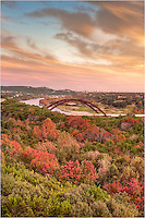 Taken just before a cold front arrived, this image shows Pennybacker Bridge with the Austin skyline in the distance. Fall colors of the Texas Hill Country lit up the view on this serene evening.